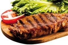 烤牛腰肉排在船上 免版税库存照片