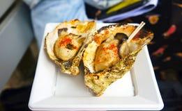 烤牡蛎用辣椒 免版税库存图片