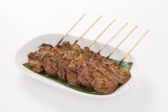 烤猪肉用竹棍子 免版税库存照片