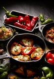 烤甜椒poppers充塞用乳酪和草本,可口开胃菜的混合 库存照片