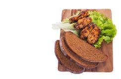 烤肉和黑面包 库存照片