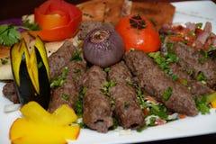 烤肉,用在白色板材的开胃菜 免版税库存图片