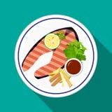 烤鲑鱼排用炸薯条 库存照片