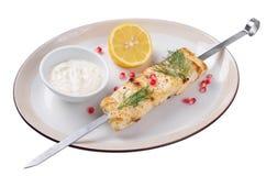 烤鲟鱼用柠檬调味汁和 查出 免版税库存照片