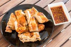 烤鸡用辣调味汁 库存图片