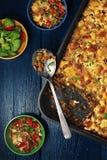烤绿色lentile和菜砂锅 库存照片