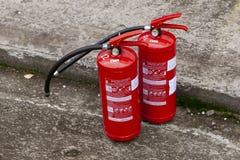 烧伤常数庭院灭火器火连续查找了危险等级香火lianhua公园掸人寺庙那里威胁 熄灭的媒介 免版税库存图片