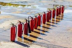 烧伤常数庭院灭火器火连续查找了危险等级香火lianhua公园掸人寺庙那里威胁 免版税库存照片