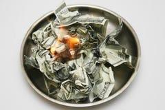 烧伤货币 库存照片