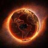烧在一个全球性灾害以后的地球 库存照片