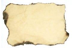 烧掉老纸张的背景 免版税库存照片