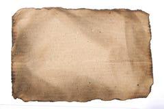 烧掉老纸背景 免版税库存图片