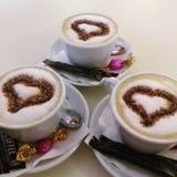 热奶咖啡三倍 免版税库存照片