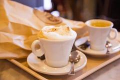 热奶咖啡和浓咖啡 库存照片