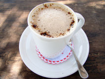 热奶咖啡杯子 免版税库存图片
