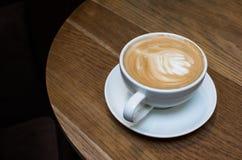 热奶咖啡盖帽  免版税库存图片
