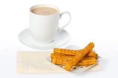 热巧克力的churros 免版税库存照片