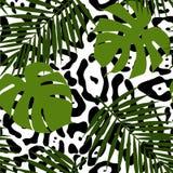 热带叶子和动物皮毛无缝的样式 库存图片