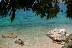 热带海滩夏天抽象背景在爱奥尼亚海的 库存照片