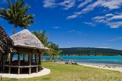 热带海滩的小屋 图库摄影
