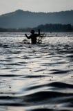 热带雨和渔夫 免版税库存照片