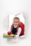 热心矮小的女小学生准备好学校 免版税图库摄影