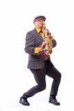 热情的传神男性女低音萨克管演奏员 免版税库存照片