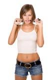 热情的女孩画象白色上面和牛仔布短裤的 免版税图库摄影