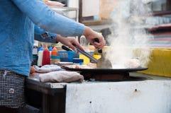 热烹调抽烟了  免版税库存照片
