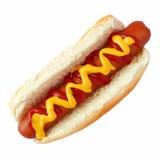 热狗用芥末和番茄酱,顶视图隔绝在白色 免版税库存照片