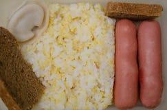 热的午餐的准备好部分 库存图片
