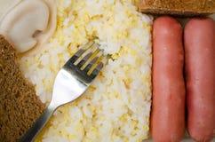 热的午餐的准备好部分 免版税库存照片