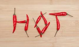 热的文本由红辣椒制成在表 图库摄影