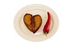 热的红辣椒和心脏多士 库存图片