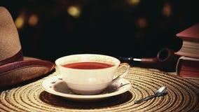 热的茶杯金bokeh帽子烟斗书没人hd英尺长度 影视素材