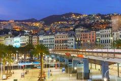 热那亚在晚上,意大利老镇和高速公路  免版税库存照片