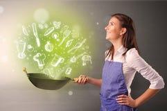 烹调与绿色乱画菜 免版税库存照片