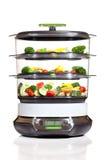 烹调健康蒸汽蔬菜的烹饪器材 图库摄影