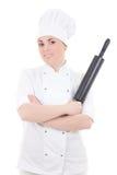 烹调制服的妇女有烘烤在白色隔绝的滚针的 免版税库存照片