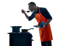 烹调厨师剪影的人被隔绝 库存照片