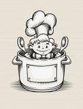 烹调在厨房里的微笑的男孩 免版税库存图片
