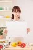 烹调在有空间的厨房里的妇女复制的 图库摄影