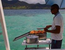 烹调在游艇的甲板工 图库摄影