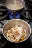 烹调在火炉的食物 库存照片