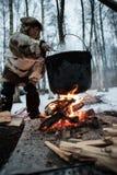 烹调在火的一个罐 库存照片