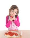 烹调女孩少许薄饼 图库摄影