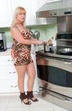 烹调妇女 图库摄影