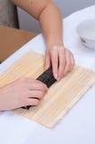 烹调寿司 免版税库存照片