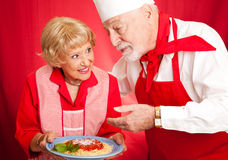 烹调教训的祖母 库存照片