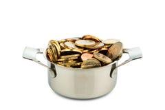 烹调有硬币的罐 免版税库存图片